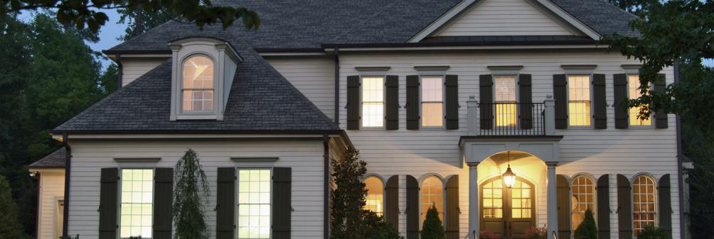 Residential home exterior with lighting